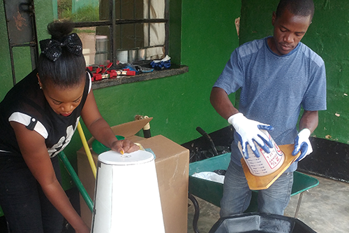 Chipata District Farmers Association fabricators Dorica and John work on universal nut sheller molds