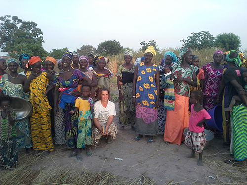 [Erin Schneider poses with a group of women farmers in a village near Kaolack, Senegal, after a composting demonstration.]