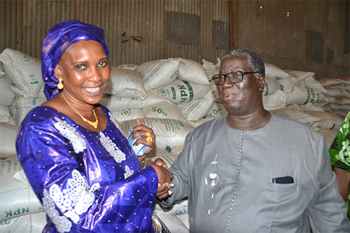 Seynabou Fall, left, president of the Inter-Regional Millet Union, with a buyer of more than 1,000 tons of high quality millet.