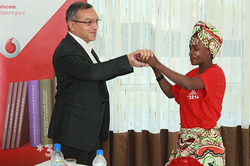 A farmer dances with a Vodacom representative at the launch of the 321 mobile system.