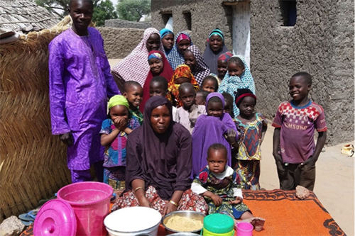 Rahiba Aboubacar poses with her family. Her youngest daughter, sitting to her right, is a testament to the results of a nutrient-rich diet early in life.