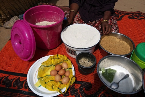 Rahiba displays the ingredients that go into the enriched flour she makes for her community.
