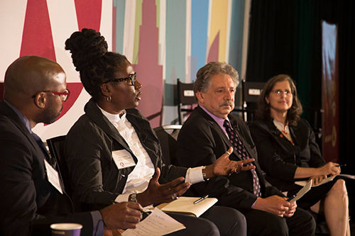 Sutton, second from left, talks about the intersection of cooperatives and community economic development at last year's Co-op IMPACT Conference.