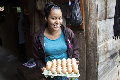 Tania Hernandes has increased access to protein in her community by raising chickens and selling their eggs.
